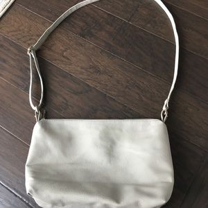 Light gray leather purse with adjustable strap